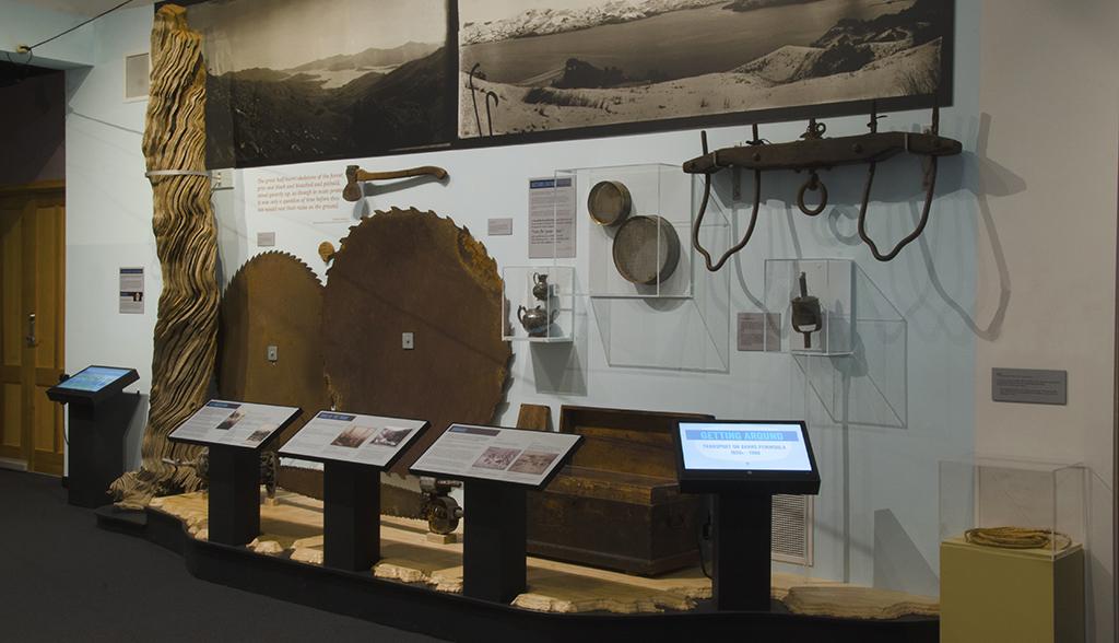 Large photographs, saw blades, bullock yoke